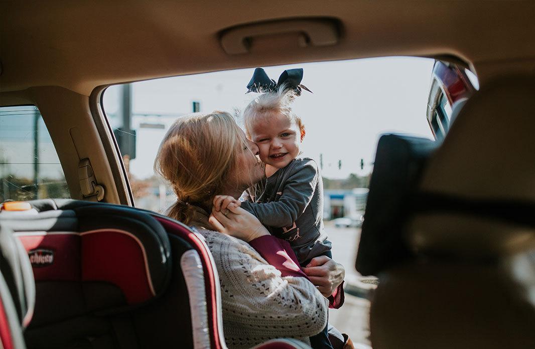 car mother daughter